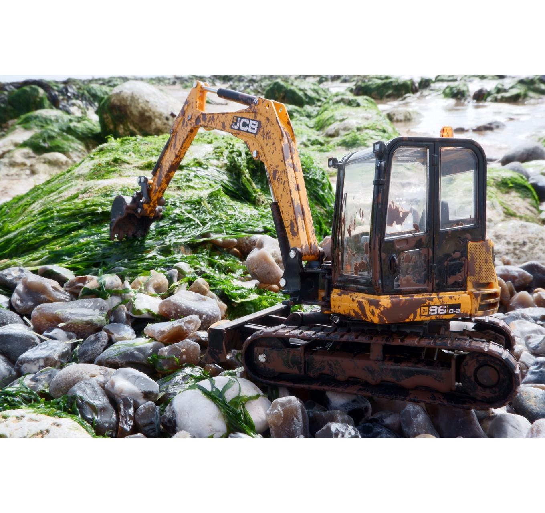 JCB Muddy Midi Excavator